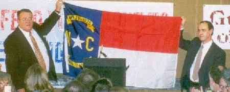 Sen. Hugh Webster (R-Caswell) presents GRNC with a gift of a long-needed North Carolina flag. - Photo by Jim Barnard